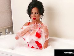 Nikki Benz washes her thick tits in a soapy bathtub!