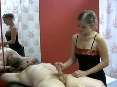 Masseuse is focused in masturbating her visitor for other