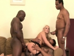 Horny blonde gets a pair of black penises