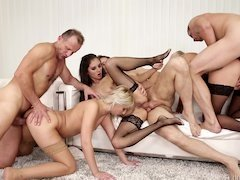 Chicks are doing an group orgy with some lads at a swingers party