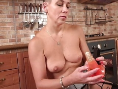 Modern old mom feeding her unshaved snatch on kitchen