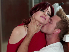 A redhead milf is getting her cunt pounded hard on the kitchen table