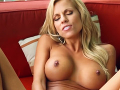 A blonde takes off her bra and also then she removes her panties
