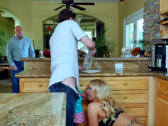 A nice blonde is milf is giving blowjob off a young-looking stud in the kitchen