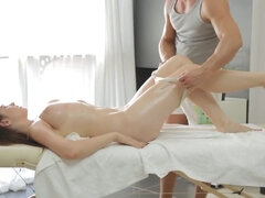Massage therapist seduces young busty brunette