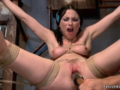 Tied and spreaded brunette slave toyed