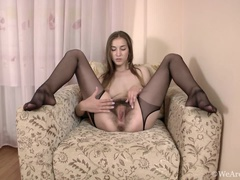 Halmia strips naked naked and masturbates with toy