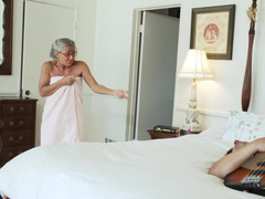 An old woman is getting her loose old pussy fucked on the bed