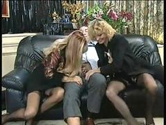 Stockings clad gals from France have fun with strapon