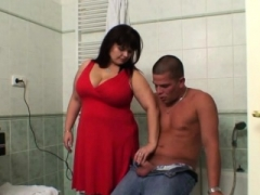 Breasty mom and son-in-law getting down and dirty in the bathroom