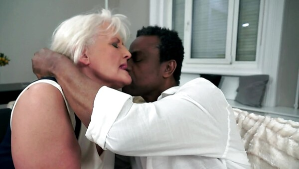 A granny gets her large saggy tits groped by a large black man