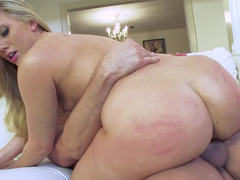 Blonde that has a huge ass is getting two large cocks in her ass