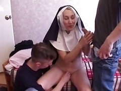 Nun has an intercourse with a couple of young and fresh lads