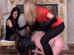 Foot slave double stomped & spanked during a pony play by two mistresses