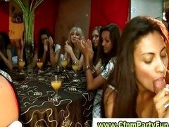 Party women tasting purple rod tails