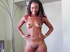 Ebony broad is on her knees and is sucking a hard cock