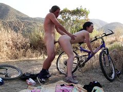A couple makes a break from bike riding and additionally then they get down and dirty