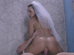 A sexy blonde in a wedding dress is getting penetrated by a dude