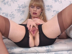 Bushy lady Heidi in stockings shows off her hairy pussy and armpits
