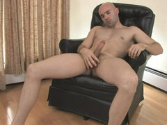 Horny bold dude jerks off his hard tool on a chair