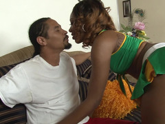 A black woman sucks a cock and she also gets licked by a man