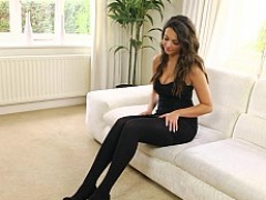 Brunette in tights slowly unclothing