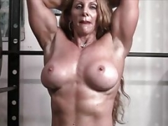 Undressed Female Bodybuilder Redhead Cougar Topless in Gym