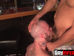 Bartender bends over on the table and fistfucked anal