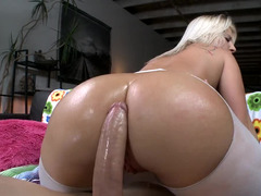 A massive dildo is plugging a large ass. The blonde loves that