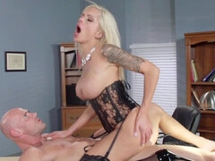 Tattooed blonde with glasses is having sex